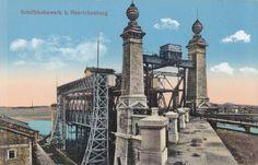 Die Postkarte stammt aus ca. 1900 bis 1905 und zeigt das 1899 erbaute alte Schiffshebewerk Henrichenburg, das die Verbindung Dortmund/Duisburg (über Rhein-Herne-Kanal) und Dortmund/Papenburg (Ems) ermöglichte. Der Blick Richtung Westen zeigt die Zwiebeltürme im Oberwasser und die Stahlkonstruktion, die etwa 14 m Wasserstandsdifferenz ermöglicht. Das Hebewerk wurde 1969 stillgelegt, es ist heute ein Museum.