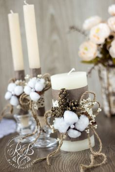 Unity candles change the pine cones to dusty miller and the brown ribbon to sage ribbon
