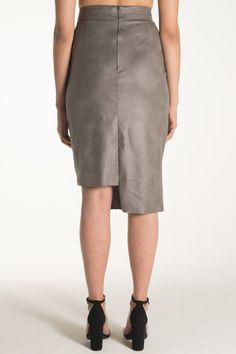 Meet Keris.   Stretch faux leather cutout pencil skirt with asymmetrical hemline. Sexy peekaboo suede cord laced cutout detail makes this skirt exciting and one-of-a-kind. High waisted. She's exciting, and one of a kind. Just like you.   Available for pre-order NOW.