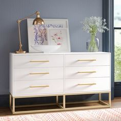 Alive with natural beauty and a dynamic modern pattern, this contemporary dresser brings élan to any bedroom. Designed with substantial brass metal hardware and legs, it's generous six drawers make it as functional as it is stylish. White And Gold Dresser, White Gold Bedroom, Gold Bedroom Decor, Room Ideas Bedroom, Modern Bedroom, Girls Bedroom, White Dressers, White Bedroom Dresser, White And Gold Bedroom Furniture