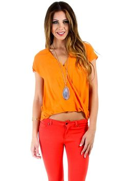 $16 at www.heavenlycouture.com Naked Zebra Sleeveless Wrapped Blouse in Orange : Tops