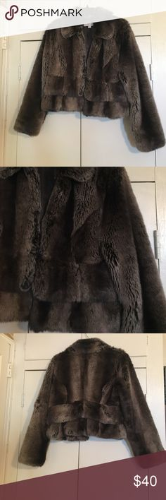 Faux Fur Jacket This listing is for a faux fur jacket. The coloring is brownish taupe on the darker side. Very warm and cozy!! The closures are eye hooks like on a regular fur coat. Thank you for stopping by my closet! 🌸 New York & Company Jackets & Coats