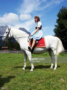 Peaches Geldof sits on a lipizzan horse at the Stanglwirt Hotel on August 23, 2010 in Going, Austria. IT-Girl Peaches, daughter of singer Bob Geldof, came to Tyrol for a photo session at the Bio-Hotel Stanglwirt. The traditional dress of owner Maria Hauser fascinated her and she wanted to wear for this picture on a white lipizzan horse in front of the 'Wilder Kaiser' mountain the traditional 'Weisswurst-Party' Dirndl.  |  S❤