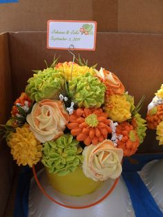 6 Beach themed bouquets in sand buckets the customer gave me.  Buckets yellow, orange and lime green.  Didnt have time to shoot a proper pic, barely got this as it went out the door.  Couple got married in Fiji last Dec. but celebrated on west coast with fam and friends with a recep. on the beach.  They wore their wedding clothes to surf in before the reception began.  TFL