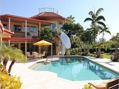 Check out how this house incorporated a water slide to go with their pool!