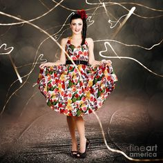 Creative fashion portrait of a woman dancing in colorful floral dress outdoor. Retro love by Ryan Jorgensen
