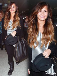 Demi Lovato. No makeup (from what I can see), ombre hair with relaxed curls. Beautiful and simple.