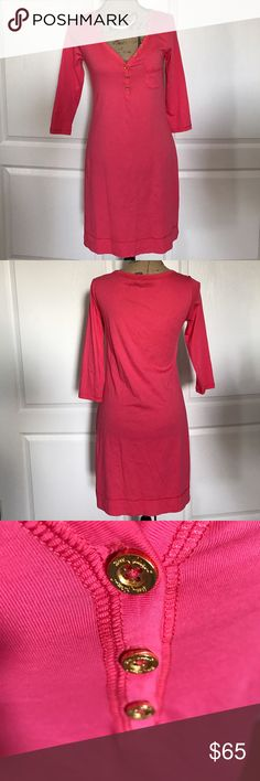"""Lilly Pulitzer Island Coral Palmetto Dress Lilly Pulitzer Island Coral Palmetto Dress. Size Small, EUC, 100% Pima cotton, 3/4"""" sleeves, gold toned buttons, v-neckline, t-shirt dress, cool and casual. Offers are always welcome. Smoke free home and ready to ship.   Dress measurements  Chest- 33"""" Waist- 32"""" Hips- 36"""" Overall Length-35 1/2"""" Shoulder- 15 1/2"""" Sleeve- 17 1/2"""" Lilly Pulitzer Dresses Midi"""