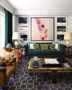 color combo emerald sofa, moss green pillows, camel leather chairs