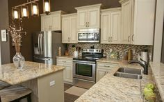 Beautiful kitchen cabinets and granite countertops. Love the light fixture!!