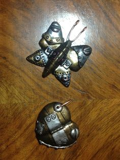 Polymer clay steampunk pendants by Lydia Quayle