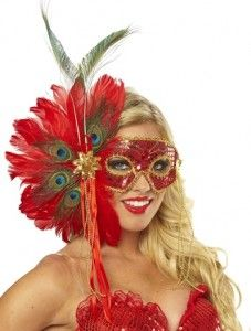 Spanish Peacock Feather Mask w/ this red sequined mask that's trimmed in braided gold.  It's covered in red jewels w/ gold antennae that have bright green jewels attached to the ends.   A red sequin flower attaches to the brilliantly red feathers that have multi-colors eyes dispersed throughout the mix.  A little red ribbon & gold chains add some extra sex appeal.