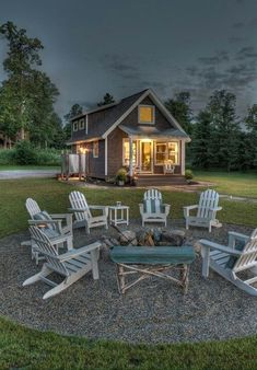 adirondack chairs around low fire pit. Love the circle of gravel -