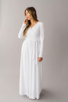 LDS Mormon White Temple Dress There's only one problem with Hero; Hero is a multi-panel swing dress made o Modest Wedding Gowns, Wedding Dress Sleeves, Dresses With Sleeves, Lds Temple Clothing, Modest White Dress, Temple Dress, Baptism Dress, Winter Wedding Inspiration, Tie Dress