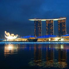 Singapore by night.  One of my favorites! by thetravelingworld