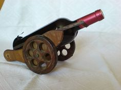 I give you this old bottle holder that looks like an old gun. It is made of wood and metal. Its dimensions are 29 x 14 x 17 x x This is a wonderful gift for wine lovers. The rack will add an old atmosphere to your table. Bottom of the bottle is placed on Lighted Wine Bottles, Old Bottles, Antique Bottles, Vintage Perfume Bottles, Bottle Lights, Antique Glass, Wooden Wine Bottle Holder, Beer Bottle Crafts, Bamboo Crafts