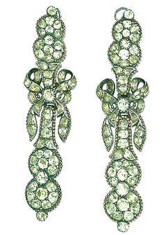 Late 18th century Portuguese silver pendant earrings, the double cluster tops linked to ribbons tied in bow-knots and double cluster pendant drops. The earrings are densely set with foiled, sea-green chrysoberyl in closed back settings. The border of gold bead work is a distinctively Portuguese feature. The earrings have their original reverse silver ear fittings with wig loops. The earrings are 3 and 1/4 inches long. For identical, see L. d'Orey, Five Centuries of Jewellery, figure 151.