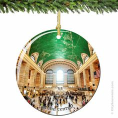 """Grand Central Christmas Ornament, Grand Central Terminal in Porcelain  The charm and beauty of Grand Central is captured in this original New York City Christmas ornament. Grand Central has never looked so glorious.   We are proud to offer you these double sided porcelain Grand Central Christmas ornaments.  We are sure they will be cherished in your family for generations.   Measures 2.75"""" Round   (http://www.nycwebstore.com/grand-central-terminal-porcelain-christmas-ornament/)"""