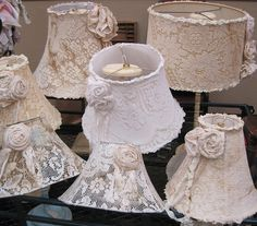 Lace lampshades ~ turn a plain shade into a piece of art using lace, ribbons, flowers, trims, beads, even paint ~ the ideas are endless. A solid colored shade looks great when covered in lace, you don't have to start with a white or cream base.  {These are plain next to mine, lol.}