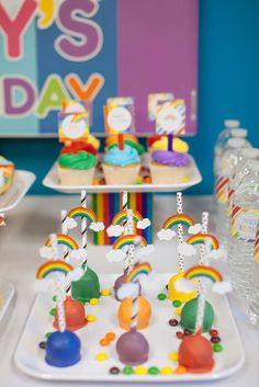 Cake pops at a rainbow birthday party! See more party planning ideas at CatchMyParty.com!