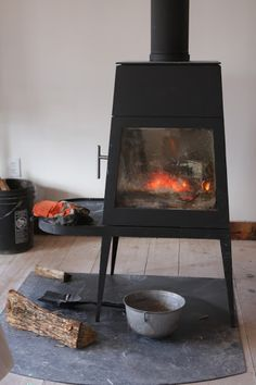 Shaker design series by Wittus.com. The large studio space is made cozy by this wood-burning stove.  It's a Shaker design made by Wittus.  http://www.wittus.com/