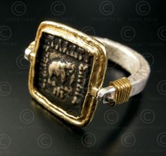 Bactrian coin ring | Reversible ring in 24ct gold and silver set with a silver drachma Bactrian king Apollodotus Sterling I (r. v -180 to -160.), Found in Afghanistan. Design by François Villaret.
