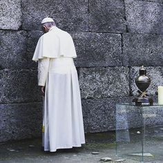 """""""Out of the depth I call to you, Lord; Lord, hear my cry! May your ears be attentive to my cry for mercy"""" from Psalm 130: 1  In the photo #PopeFrancis is praying  before the Wall of Death in #Auschwitz, #Poland. 📷 by Jeffrey Bruno  #Krakow2016 #wyd2016 #catholic #catholicchurch #pope #sdm2016"""