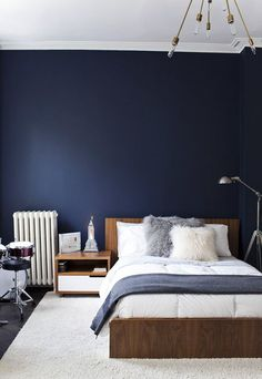 Gorgeous combination of deep denim blue and warm timber tones. Boys room
