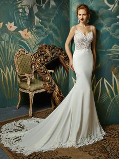 Juri by Enzoani - A modern & sophisticated crepe mermaid style gown. The beautiful low-back and dramatic train give this sexy wedding gown an untraditional look.