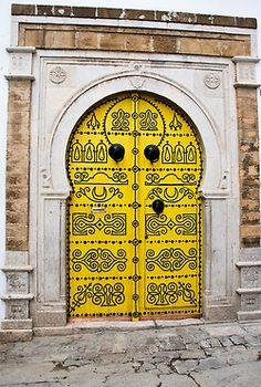 Yellow door with black scrollwork