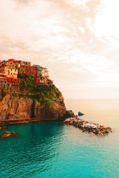 Cinque Terre, Italy. My most favorite place in Italy next to Venice that I have been too. We hiked the off beaten trail to the five fishing villages of this place. It was well worth the effort, gorgeous....