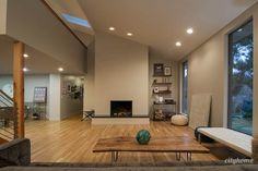 Modern interior, clean lines, fireplace, hardwood floors  #cityhomecollective