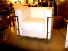 Pair of White Leather Club Chairs in the Style of Le Corbusier | From a unique collection of antique and modern club chairs at http://www.1stdibs.com/furniture/seating/club-chairs/