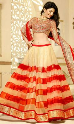 If you don't want to mix and match colors, go all red !! Of course with a tint of cream in it like this lehenga with a blouse so attractive that it will make you look like an epitome of glamor. #happybride #fashion #shaadimagic #bridalwear #instagood #lady #lehenga #saree #loveher #bridallook #amazing #bollywoodbride #lehengacholi #red #ethnic #beauty #st