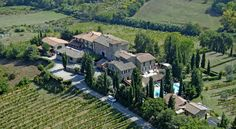 Hotel Pescille San Gimignano Hotel Pescille is set in an old farmhouse in the Tuscan countryside, 5 minutes' drive from San Gimignano. It offers a large garden with swimming pool, and free parking.  All rooms have air conditioning, satellite TV, and a minibar.