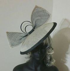 Check out this item in my Etsy shop https://www.etsy.com/listing/468957171/ecru-and-black-wide-brimmed-fascinator