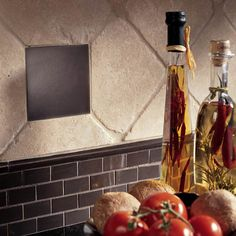 Dalile kitchen featuring Urban Metals in Bronze 4-1/4 x 4-1/4 and 1 x 2 Brick joint wall tile trimmed in 3/4 x 12 Ellipse wall liner. Tumbled Stone in Baja Cream 6 x 6 in diamond pattern. Daltile grout #228 Walnut. See more at daltile.com