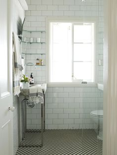 Narrow stone sink and glass shower really enlarge this small bathroom - and loving the floor, of course!