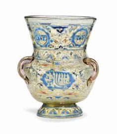 A SMALL ENAMELLED GLASS MOSQUE LAMP BY AUGUSTUS JEAN -   CIRCA 1880, SIGNED A. JEAN IN RED SCRIPT -   Of Mamluk style applied with three lug handles, painted in raised enamels and gilt with medallions of script surrounded by stylised floral motifs  6 ¼ in. (16 cm.)