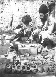An attar selling perfumes, spices and herbal medicines. Photograph by Antoine Sevruguin.