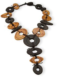 """Staci Louise Smith carved this flat polymer disk necklace as part of her winning entries in this year's Bead Dreams contest at the Bead and Button show. Found on Polymer Clay Daily, June 17, 2014. See """"Stacy Louise Originals"""" for more: http://www.stacilouiseoriginals.com/"""