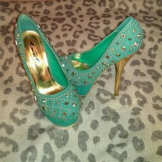 High heel shoes Mint green with gold studs. I have only worn them once. They are in very good condition. They are six inch heels with a two inch platform ALBA Shoes Heels