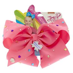 Give your look a POP of color with this vibrant pink hair bow by JoJo Siwa. The large bow is decorated in multi-colored round and heart rhinestones. Jojo Hair Bows, Jojo Bows, Pink Hair Bows, Jojo Siwa Hair, Jojo Siwa Bows, Jojo Siwa's Number, Jojo Siwa Birthday, 22nd Birthday, Kids Toy Shop