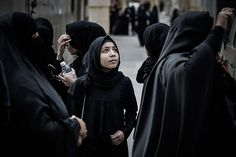 Bahraini Shia Muslim women gather for a demonstration against the death of a child in the village of Daih. The child, Qassim Habib Marzooq, died in hospital after respiratory complications. His relatives claim his death is due to the inhalation of teargas fired by riot police