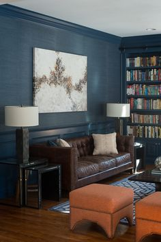 Deep navy blue paint (Benjamin Moore's Newburyport Blue) for wall paneling, baseboard & crown molding and wallpaper in the same color. (houzz)