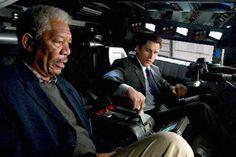 Still of Morgan Freeman and Christian Bale in Batman Begins
