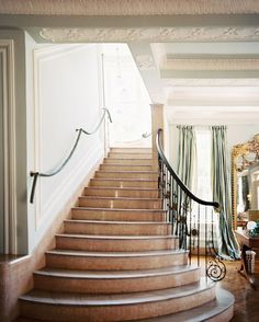 French - A marble staircase with ornate bronze-and-iron railings