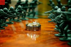 Photography: This is a unique way to photograph the newlywed's rings from a military themed wedding