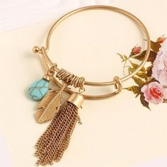 Charmed bangle Gold tone with chain tassel and turquoise stone Boutique Jewelry Bracelets