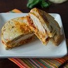 Chicken Parmesan Panini - Crispy pan-fried chicken cutlets are sandwiched between thick slices of crusty bread with mozzarella cheese and traditional tomato sauce, then toasted in a panini press.